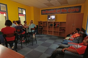 Teens watch a video on bullying in the new In Search of Me Cafe